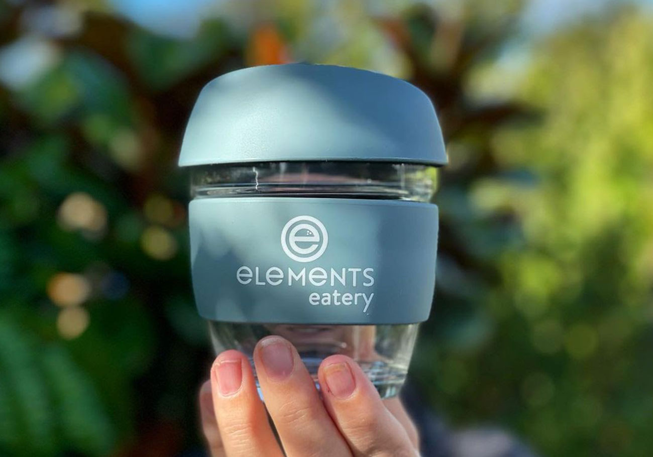 elements eatery logo displayed on a reusable coffee cup