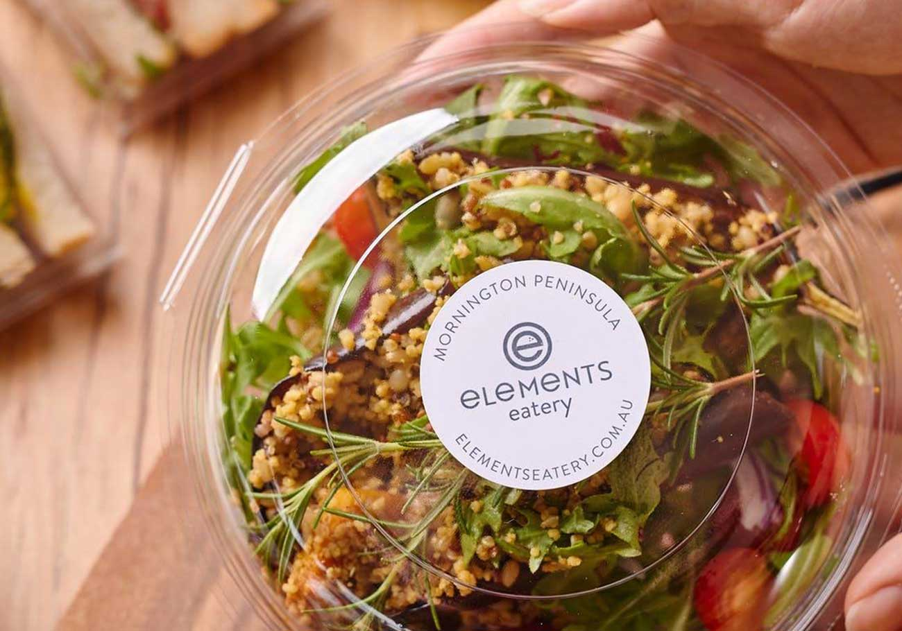 elements eatery logo displayed with sticker on salad takeaway container